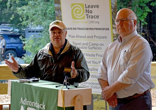 Adirondack Mountain Club Executive Director Neil Woodworth, left, and New York State Department of Environmental Conservation Region 5 Director Bob Stegemann speak at a Leave No Trace event at the Adirondak Loj outside Lake Placid on Thursday morning, Aug. 8, 2019.