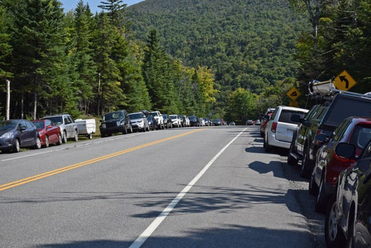 Hundreds of cars line the sides of New York state Route 73 near the Cascade Mountain trailhead outside Lake Placid during Labor Day weekend 2016.