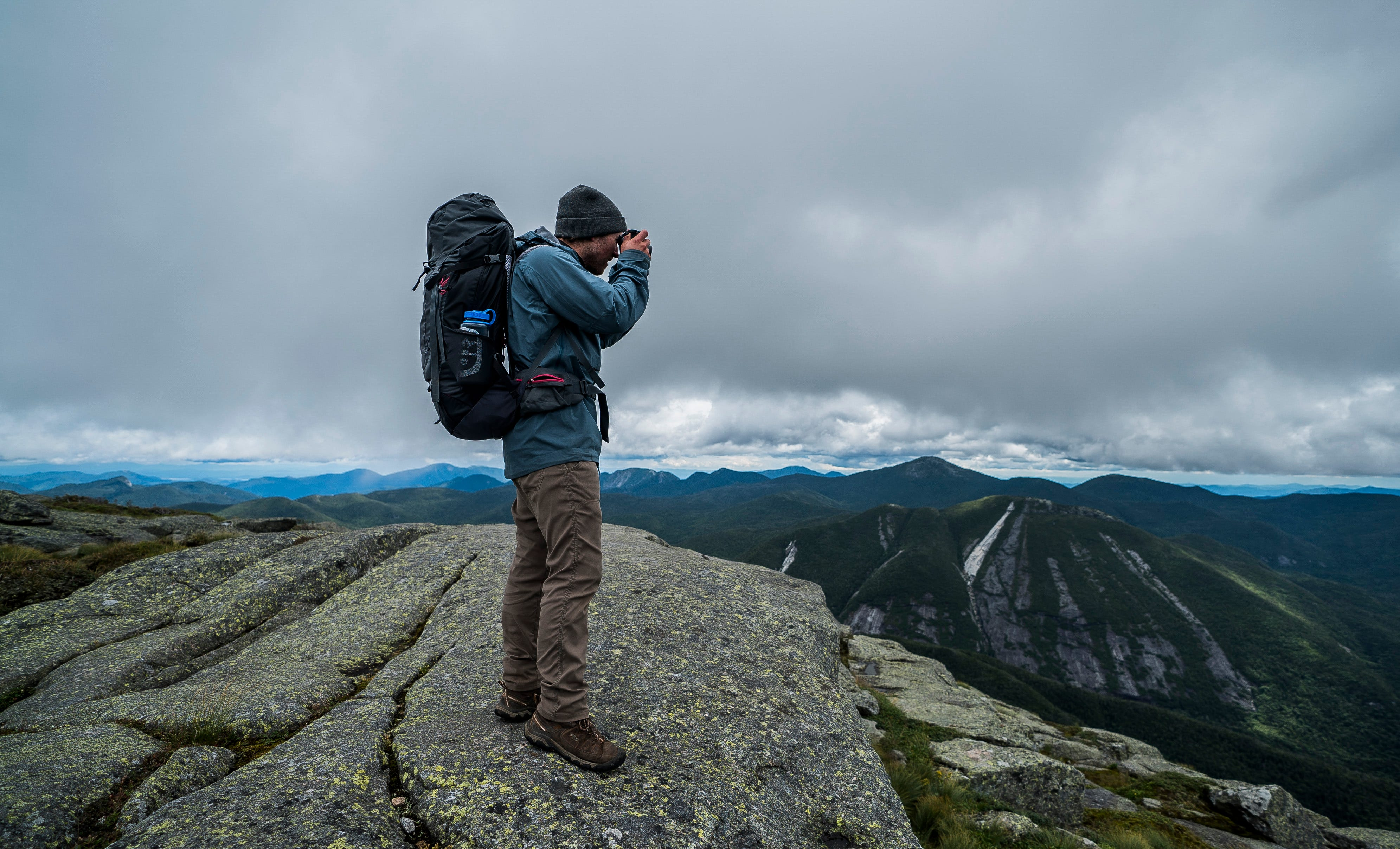 David LeMay, a traveling trainer with the Leave No Trace Center for Outdoor Ethics, takes pictures on top of Algonquin Peak in the Adirondack Park on Saturday, Aug. 10, 2019. LeMay and partner Monika Baumgart were helping summit stewards educate hikers in leave-no-trace practices while in the backcountry.