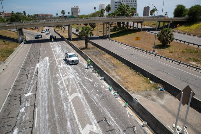 A spill of construction material closes Interstate 37 North near downtown Corpus Christi on Friday, Aug. 23, 2019.