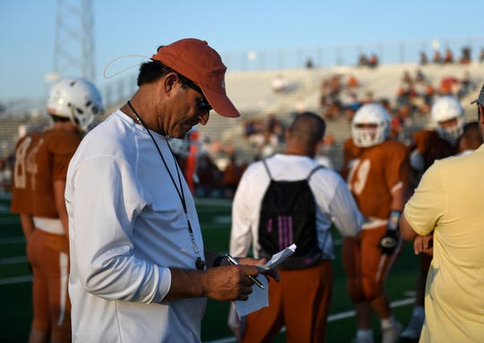 New Beeville athletic director and head football coach Chris Soza looks at his notes during a scrimmage against Calallen, Friday, Aug. 16, 2019. Soza was Beeville's head coach from 2004-2008.