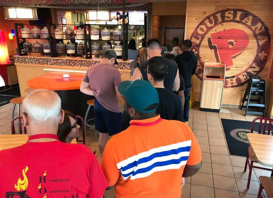 Customers wait in line at the Popeyes restaurant located on Mt Ephraim Avenue in Camden, NJ, on Friday August 24, 2019.
