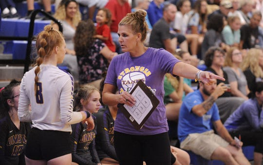 Unioto head coach Natalie Stulley talks to libero Hallie Pinkerton in a win over Chillicothe on Thursday Aug. 22, 2019 at Chillicothe High School. Stulley, who has led the Sherman program for the past three seasons, has resigned from her position.