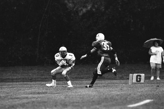 Waverly's Jason Bolin catches a touchdown pass in front of Southeastern defender Bob Lalumonider during a game in September 1993.