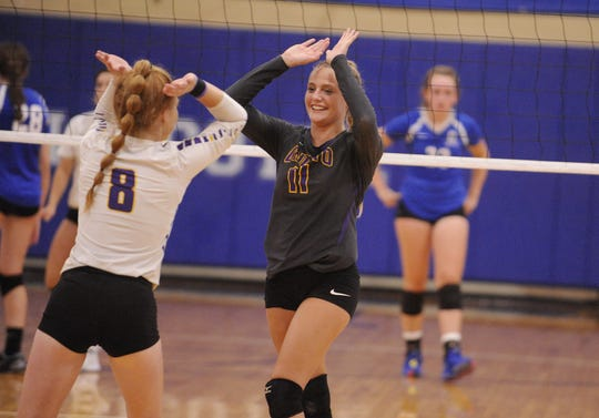 Unioto's Emily Coleman high fives teammate Hallie Pinkerton during the Shermans' 3-2 win over Chillicothe on Thursday Aug. 22, 2019 at Chillicothe High School.