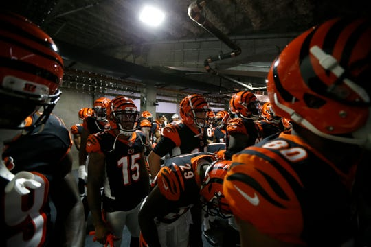 Cincinnati Bengals quarterback Andy Dalton (14) and the team prepare to take the field for the first quarter of the NFL Preseason Week 3 game between the Cincinnati Bengals and the New York Giants at Paul Brown Stadium in downtown Cincinnati on Thursday, Aug. 22, 2019. The game was tied 10-10 at halftime.
