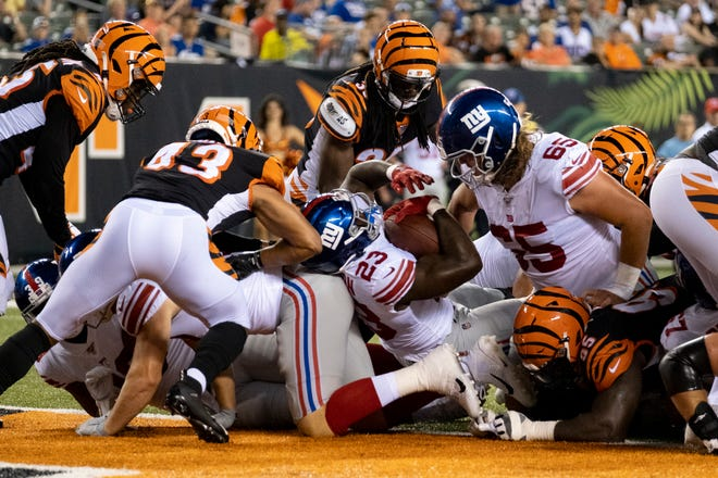 New York Giants running back Jon Hilliman (23) scores a touchdown in the fourth quarter of the NFL Preseason Week 3 game between the Cincinnati Bengals and the New York Giants at Paul Brown Stadium in downtown Cincinnati on Thursday, Aug. 22, 2019