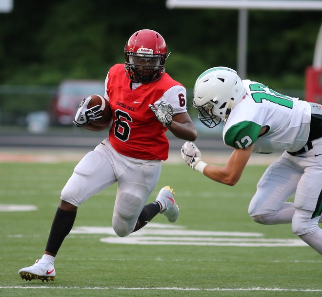 Mt. Healthy running back Darius Thomasas (6) is tackled by Hamilton  Badin's Andrew Hegemann ball during their scrimmage Thursday, Aug. 22, 2019.