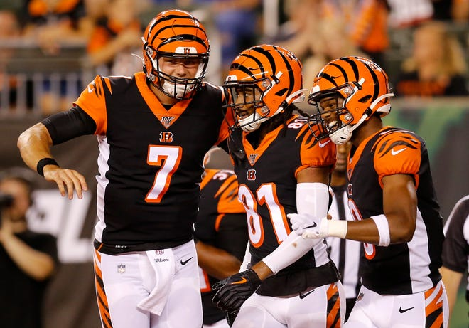 Cincinnati Bengals quarterback Jake Dolegala (7) celebrates after a wide receiver Damion Willis (9) touchdown reception in the fourth quarter of the NFL Preseason Week 3 game between the Cincinnati Bengals and the New York Giants at Paul Brown Stadium in downtown Cincinnati on Thursday, Aug. 22, 2019. The Giants won 25-23.