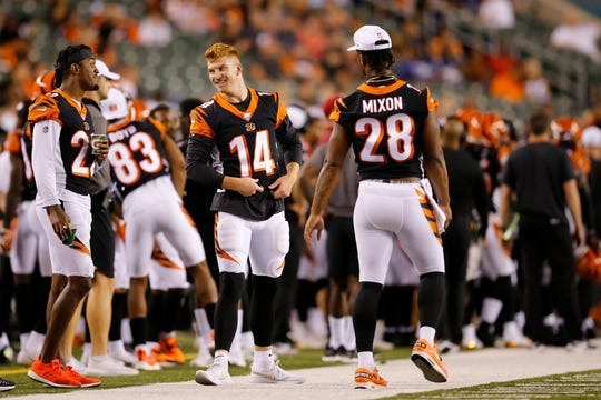 Cincinnati Bengals cornerback William Jackson (22), quarterback Andy Dalton (14) and running back Joe Mixon (28) laugh on the sideline in the fourth quarter of the NFL Preseason Week 3 game between the Cincinnati Bengals and the New York Giants at Paul Brown Stadium in downtown Cincinnati on Thursday, Aug. 22, 2019. The Giants won 25-23.