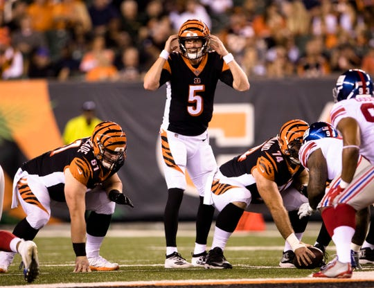 Cincinnati Bengals quarterback Ryan Finley (5) prepares to hike the ball in the third quarter of the NFL preseason game between Cincinnati Bengals and New York Giants at Paul Brown Stadium in Cincinnati on Thursday, Aug. 22, 2019.