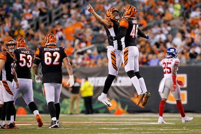 Cincinnati Bengals tight end C.J. Uzomah (87) and long snapper Clark Harris (46) celebrate a successful 50-yard field goal kick by Randy Bullock in the second quarter of the NFL Preseason Week 3 game between the Cincinnati Bengals and the New York Giants at Paul Brown Stadium in downtown Cincinnati on Thursday, Aug. 22, 2019. The game was tied 10-10 at halftime.
