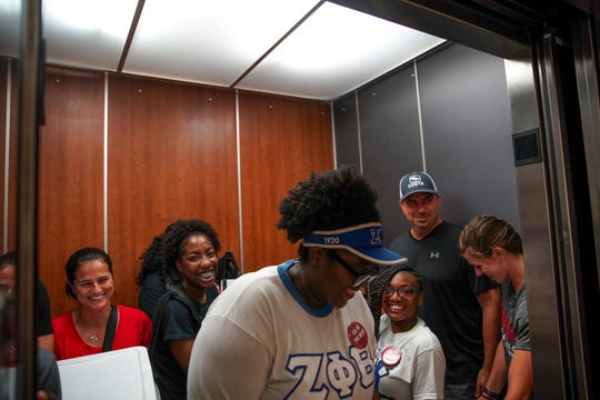 Students and family laugh as they try and squeeze in as many people as they can into an elevator on the first day of freshman move-in at Austin Peay State University in Clarksville, Tenn., on Thursday, Aug. 22, 2019.