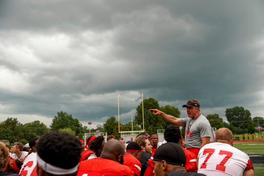 Austin Peay coach Mark Hudspeth speaks to his players at the end of practice Thursday.