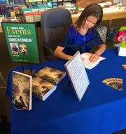 Author Christa Conklin during a recent signing at a Barnes & Noble book store.