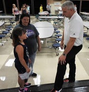 Bryan Raach speaks with Elizabeth Bradford and Jennifer Everhart during an open house at Ridgewood Middle School. Bryan, a 2001 graduate of the district, turned to the area to take the position of middle school principal.
