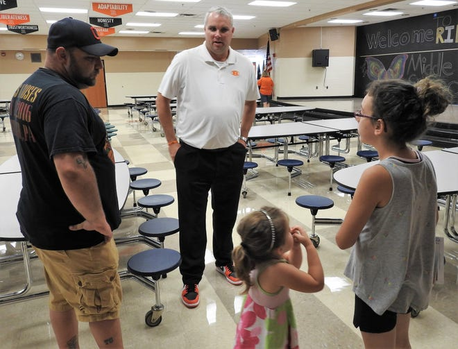 Ridgewood Middle School Principal Bryan Raach talks with students and parents at an open house prior to the start of the school year. Bryan is a 2001 graduate of Ridgewood High School. His father, Rick Raach, is a former superintendent for the district and now serves as superintendent for the Coshocton County Career Center.