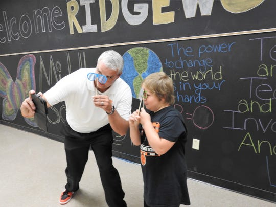 Ridgewood Middle school Principal Bryan Raach takes a silly selfie with fourth-grader Alex Postletwait at an open house prior to the start of the school year.