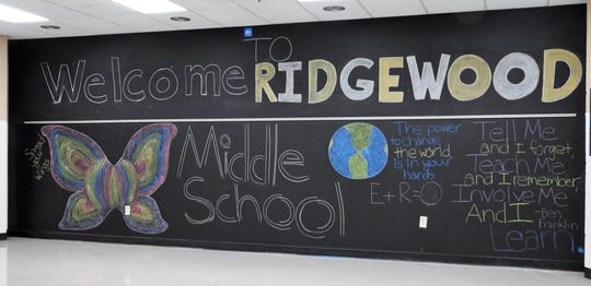 A chalk photo on the stage of Ridgewood Middle School was a backdrop for photos and meetings at a recently open house.