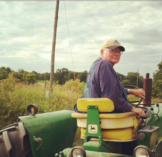 Marvin Franzen drives a tractor at Codfish Hollow Barnstormers in Maquoketa, Iowa, in this undated photo provided by the music venue.