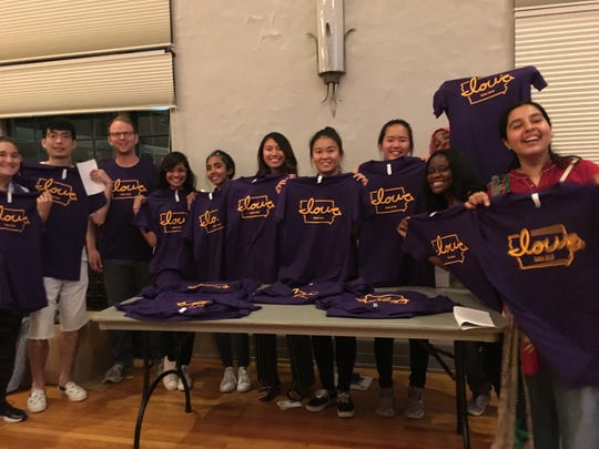 """International students at the University of Northern Iowa show off their """"Iowa love"""" T-shirts."""