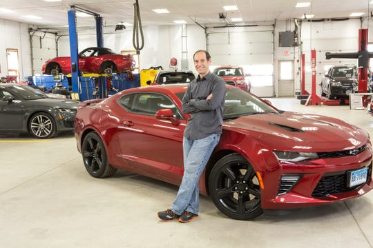 Jake Fisher, director of auto testing at Consumer Reports, stands beside a Chevy Camaro in July 2019 at the Consumer Reports Auto Test Center in Colchester, Connecticut. The site is 327 acres, operates year-round, and has about 30 full-time staff.