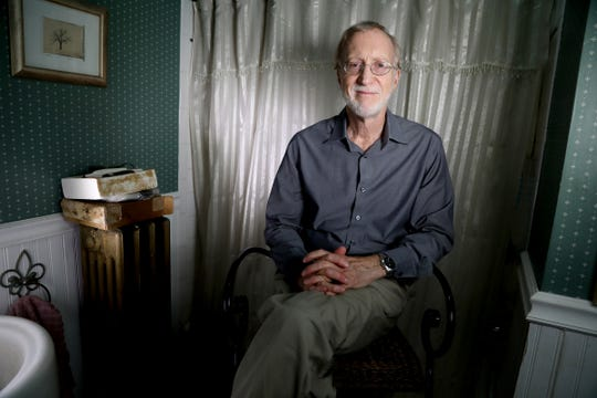 Detroit Free Press reporter Bill Laitner in the first floor bathroom of his home in Detroit on June 21, 2019. This is the spot where Laitner would always get his hair cut by his late wife Eren Stephens. She passed away in April and Laitner hasn't wanted to get his hair cut by anyone else but decided recently to start going to the barbershop a couple of blocks away on Jefferson Avenue.