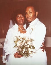 Minner and Gerald Latham are seen in a wedding photograph. The couple spearheaded a scholarship program at their church, King of Kings on Detroit's east side.