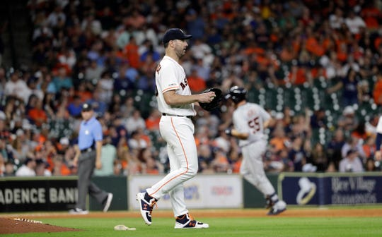Houston Astros pitcher Justin Verlander reacts after giving up a go-ahead home run to Detroit Tigers' John Hicks (55) during the ninth inning Aug. 21, 2019, in Houston.