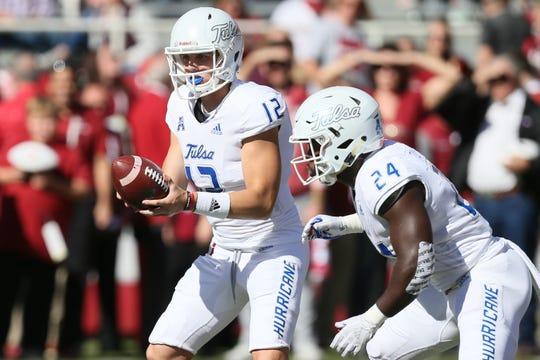Tulsa quarterback Seth Boomer holds the ball as running back Corey Taylor II awaits a handoff last season.