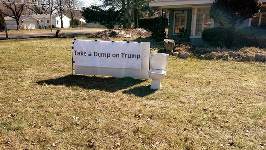 "A sign reading ""Take a Dump on Trump"" created by Livonia resident Dennis Nazelli for his front yard."