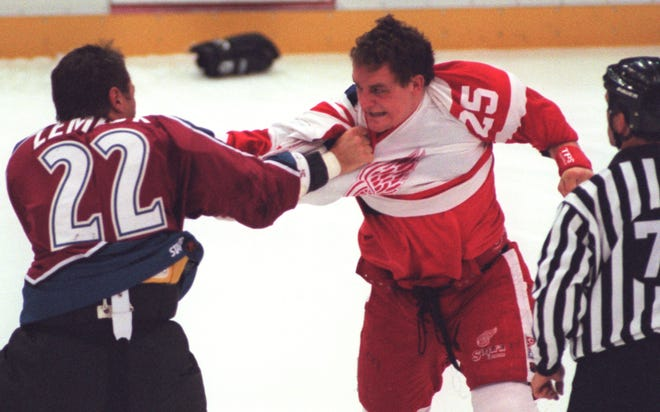 Detroit Red Wing Darren McCarty and Colorado Avalanche Claude Lemieux duke it out three seconds into Tuesday night's game at Joe Louis Arena, November 11, 1997.