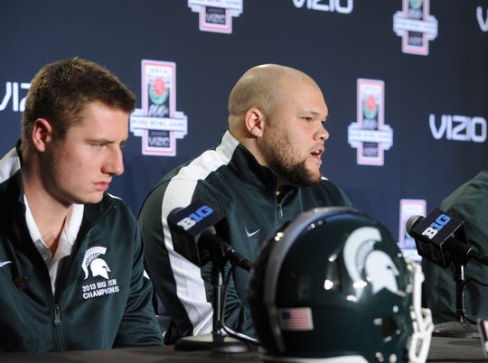 MSU quarterback Connor Cook, left, and guard Blake Treadwell speak during a Rose Bowl news conference in Los Angeles, Dec. 28, 2013.