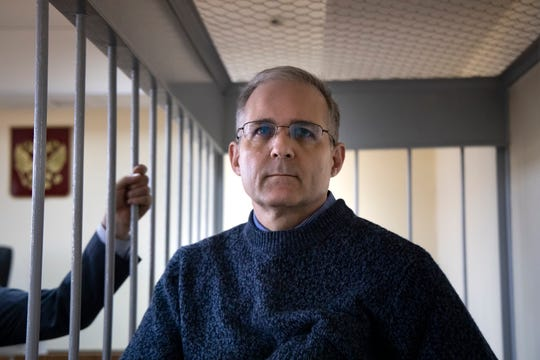 Paul Whelan, a former U.S. Marine accused of spying in Moscow at the end of 2018, stands in a cage while waiting for a detention hearing in a courtroom in Moscow, Russia, Friday, Aug. 23, 2019.