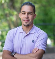 "William Lopez, a clinical assistant professor at the University of Michigan School of Public Health and author of the book ""Separated: Family and Community in the Aftermath of an Immigration Raid."""