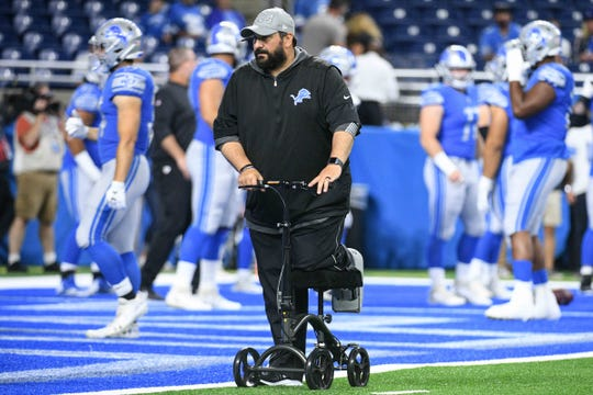 Matt Patricia rides his scooter Friday at Ford Field.