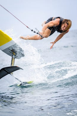 Daniel Cobb of Clarkston loses his balance on a hydrofoil. The mechanics of foil surfing require a precise level of balance and knee bending to guide the board and stay in control.