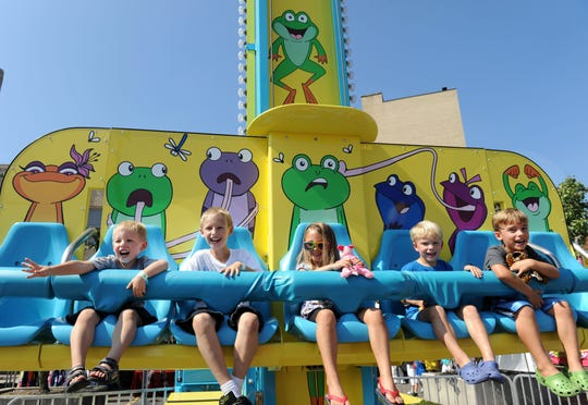 Kids go for a ride on the Frog Jump at a previous Arts, Beats & Eats festival. More family-friendly activity is in store this year in The Detroit News Kids Zone on Center between Third and Fourth.