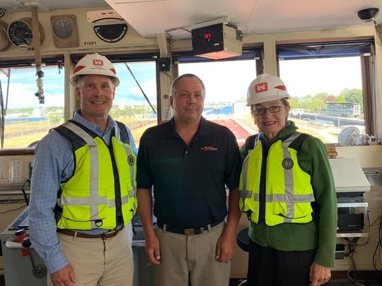 Congressman John Moolenaar and Congresswoman Marcy Kaptur with Captain Paul Berger on board the frieghter Mesabi Miner while it is in the Poe Lock in Sault Ste Marie on Thursday, August 22, 2019.