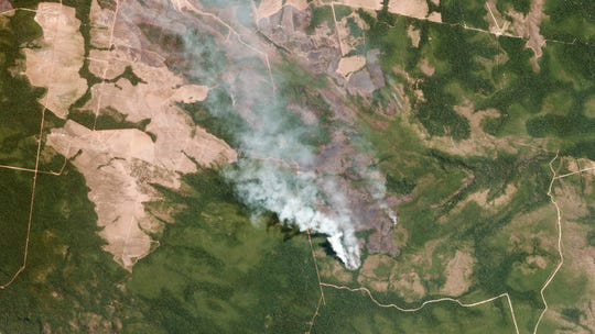 Smoke billowing from fires in Mato Grosso, Brazil.