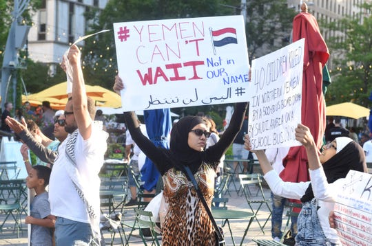 Supporters of the Yemeni Alliance Committee hold signs during a rally at Campus Martius in Detroit on Friday, August 23, 2019 to raise awareness about the devastating war in Yemen.  Max Ortiz, The Detroit News