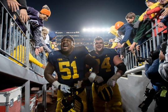 Cesar Ruiz and Ben Bredeson return to anchor Michigan's offensive line.