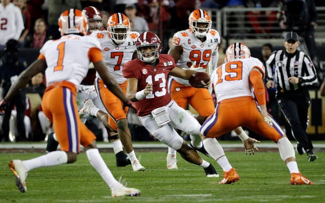 Alabama quarterback Tua Tagovailoa (13) has been studying men from the Bible, like Joseph, Moses and David.