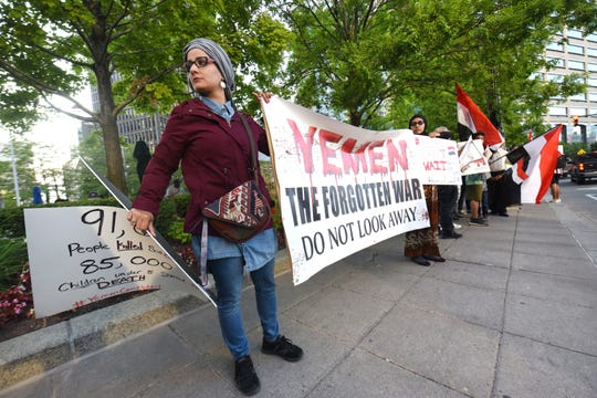 Fayzah Yahya (left) is one of many people who rallied at Campus Martius in Detroit on Friday, August 23, 2019 to raise awareness about the war in Yemen. 