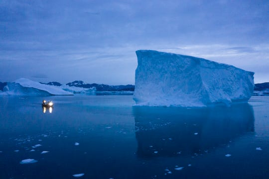 A boat navigates through icebergs in eastern Greenland. As warmer temperatures cause the ice to retreat the Arctic region is taking on new geopolitical and economic importance, and not just the United States hopes to stake a claim, with Russia, China and others all wanting in.