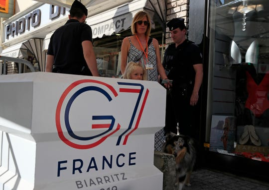 Officers inside the restricted area ahead of the G-7 summit in Biarritz, France Friday, Aug. 23, 2019. U.S. President Donald Trump will join host French President Emmanuel Macron and the leaders of Britain, Germany, Japan, Canada and Italy for the annual G-7 summit in the elegant resort town of Biarritz.