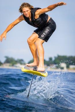 Nicholas Cobb, 16, of Clarkston cuts through the water on a hydrofoil on Lake Michigan.