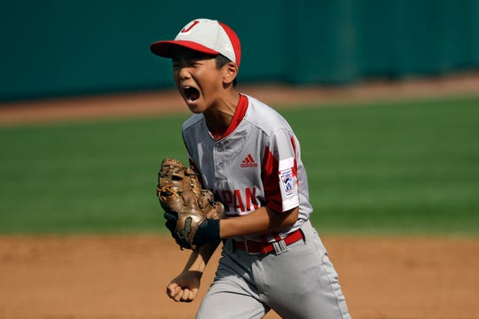 Japan's Ryohei Ushikubo (8) celebrates an inning-ending double play against South Korea earlier this week.