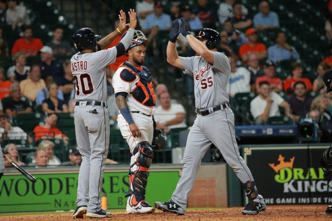 Tigers catcher John Hicks, right, is greeted at home plate after hitting his first pinch-hit home run in Thursday's 6-3 loss to the Astros.
