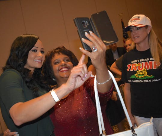 Trump Re-election Campaign senior adviser Katrina Pierson, left, poses for a photo Thursday with Denise Edwards of Royal Oak.